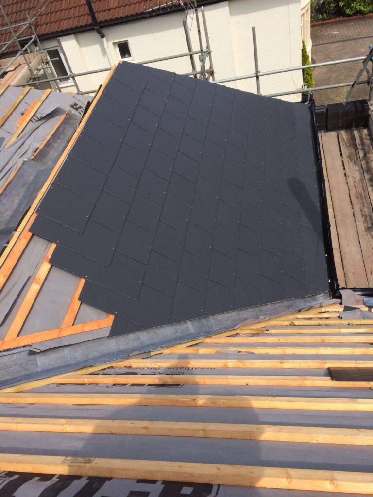 tiled roof being built
