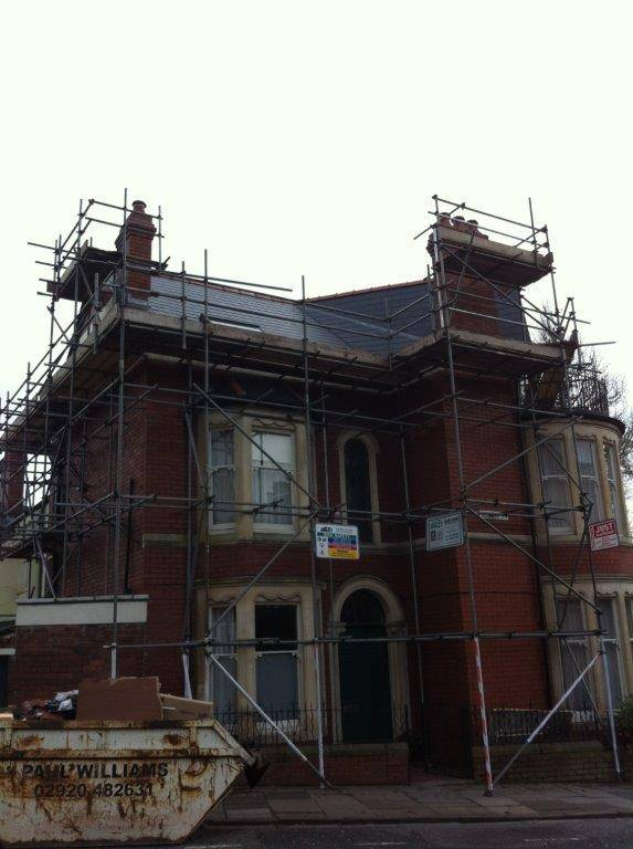 house repair with scaffolding