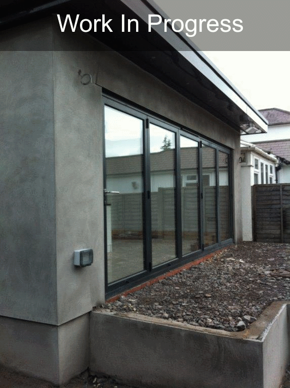 bi fold doors on grey property
