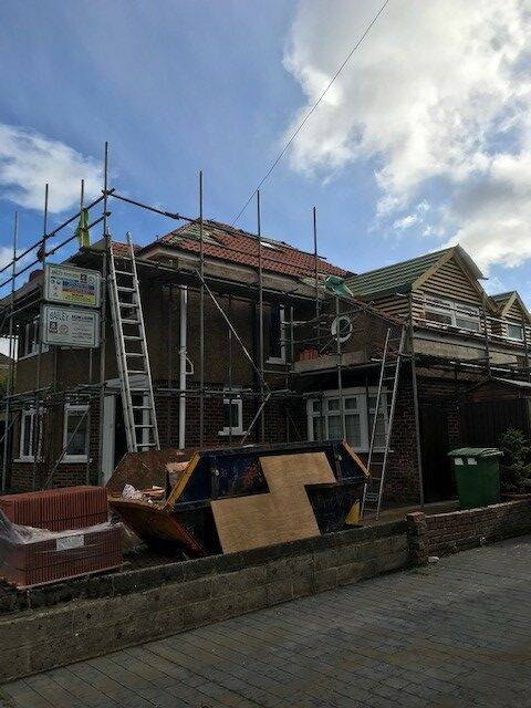 red brick house with scaffolding up