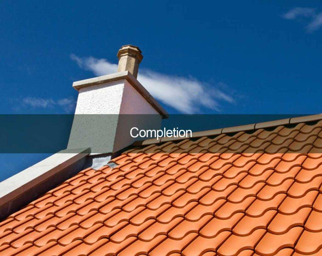 newly roofed home with new chimney stack-min