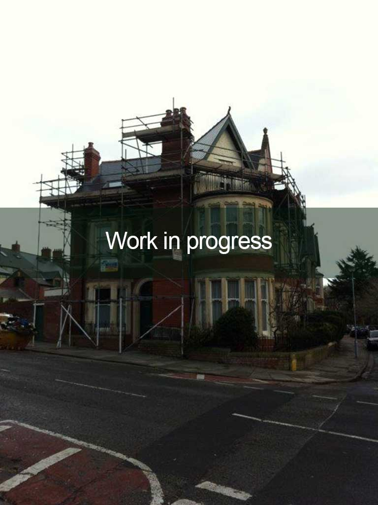 roofing work in progress on red brick house