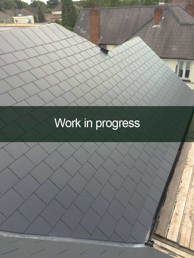 slate roofing in progress